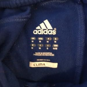 Men's blue and white soccer sweatpants.